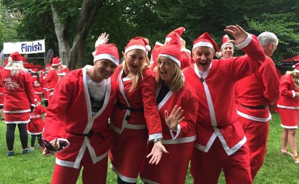 RDT Pacific Christchurch displays their jazz hands at the KidsCan 2016 Santa Run