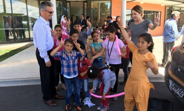 Happy Holidays from RDT Pacific. Laura Morel and Qemajl Murati Manager – Refugee Quota Branch Settlement and Protection Immigration New Zealand giving Christmas gifts to young refugees.